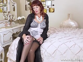 Hot mature beau diamonds in lacy corselette and nylons toying tight pussy